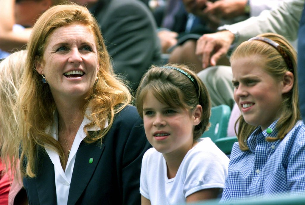 The Yorks take in a tennis match at Buckingham Palace in 2000.