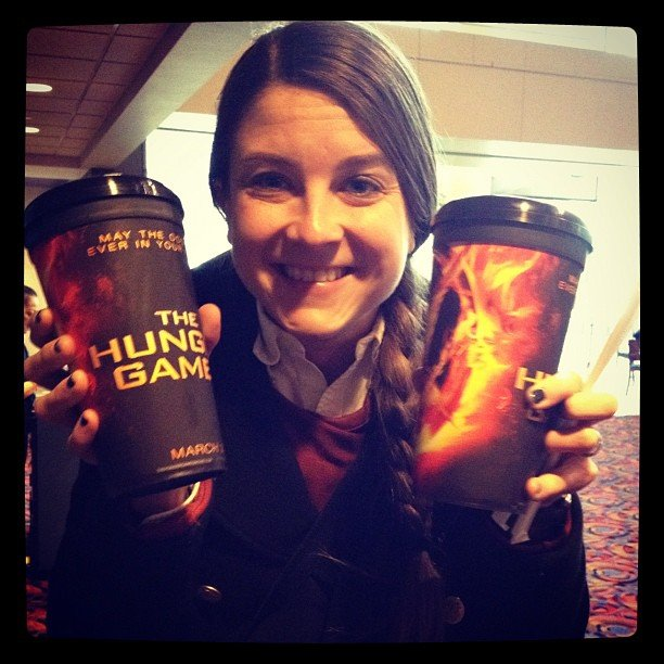 We shared a pic of PopSugar's Molly showing off a pair of the specially themed Hunger Games cups at the theater.