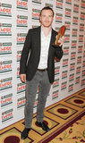 Michael Fassbender collects the hero award at the Jameson Empire Awards in London.