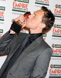 Tom Hiddleston puckers up for his award at the Jameson Empire Awards in London.