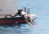 Uma Thurman dove into the ocean in a black bikini in St. Barts.