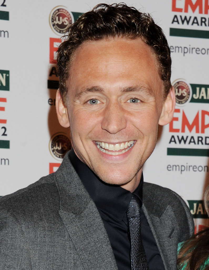 Tom Hiddleston flashes a big smile at the Jameson Empire Awards in London.