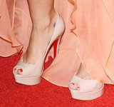 Miley paired her peach chiffon Jenny Packham gown with nude Christian Louboutin peep-toe heels.