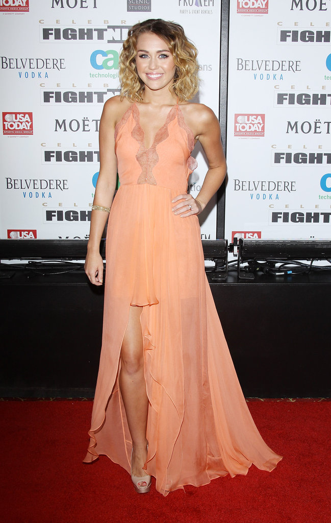Miley Cyrus stepped out on the red carpet in a peach-colored chiffon gown from Jenny Packham's Spring 2012 collection.
