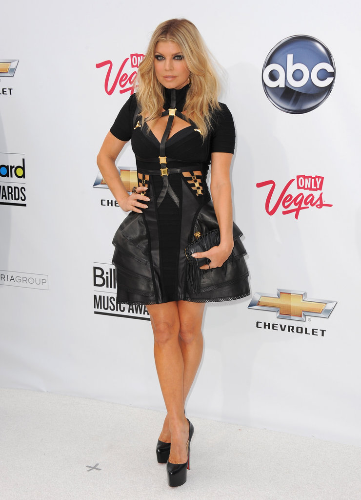 She perfected the edgy, rocker-cool red-carpet look in a short and structured Hervé Léger frock. It was a statement-making look that took full advantage of the season's fetish-inspired trend.
