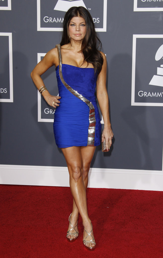 A dark-haired Fergie looked bold in cobalt blue for the Grammys in 2010, wearing a seriously smokin' Emilio Pucci minidress with snakelike metallic detail.