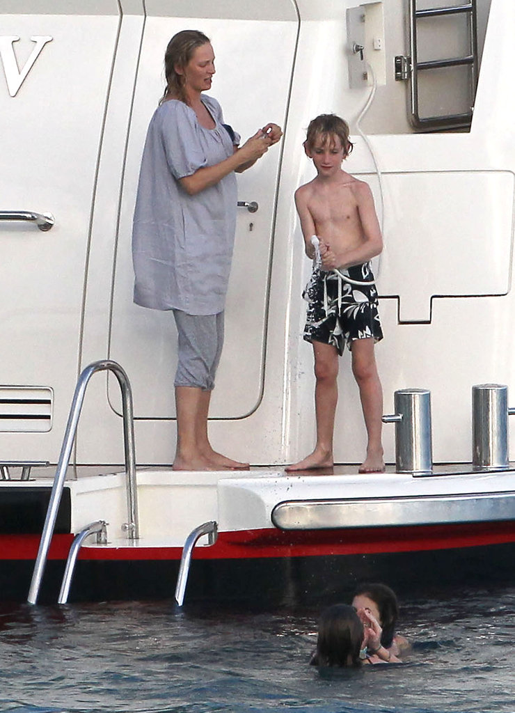 Pregnant Uma Thurman chilled on a yacht Saturday with her son, Levon Hawke, near St. Barts.