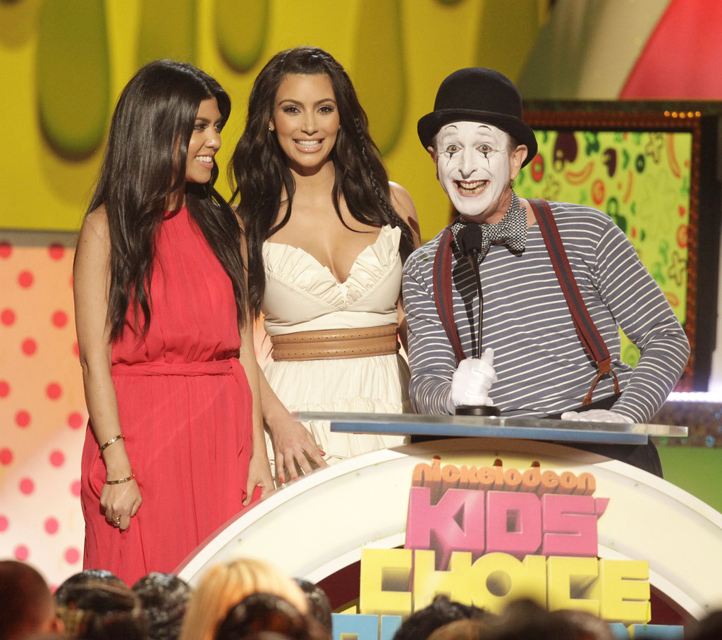 Kourtney and Kim Kardashian presented an award with a mime in 2011.