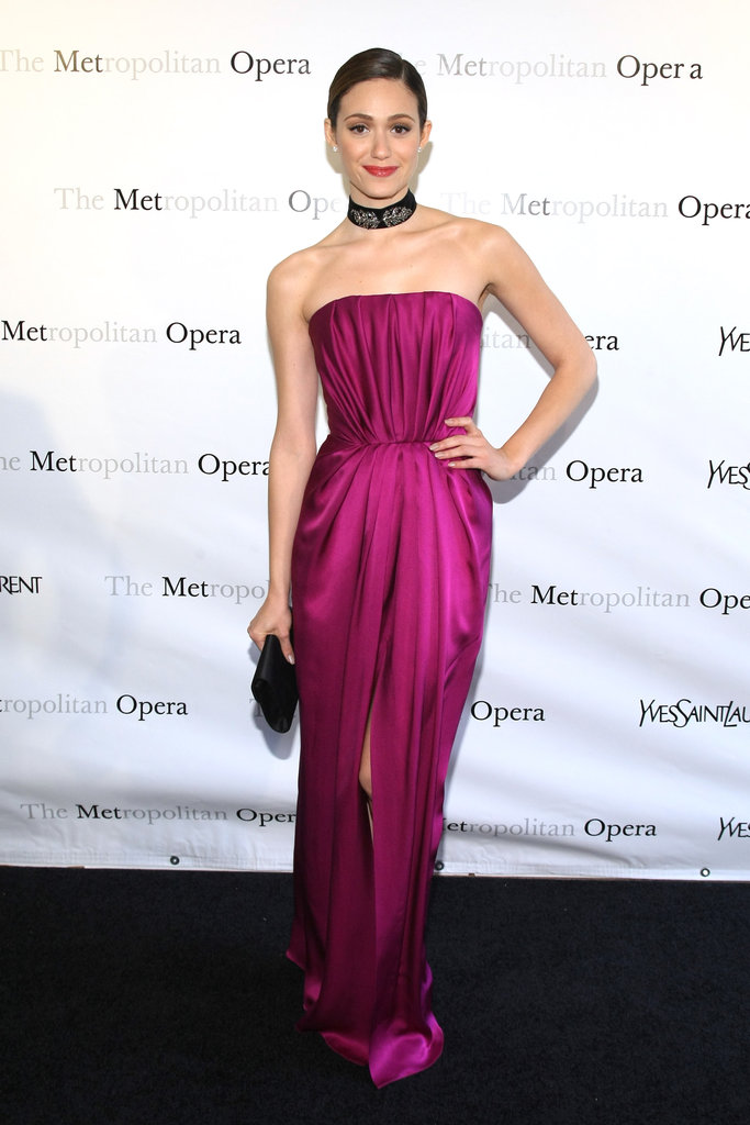 Emmy Rossum wore a magenta silk dress with a high slit to the Metropolitan Opera gala in NYC.
