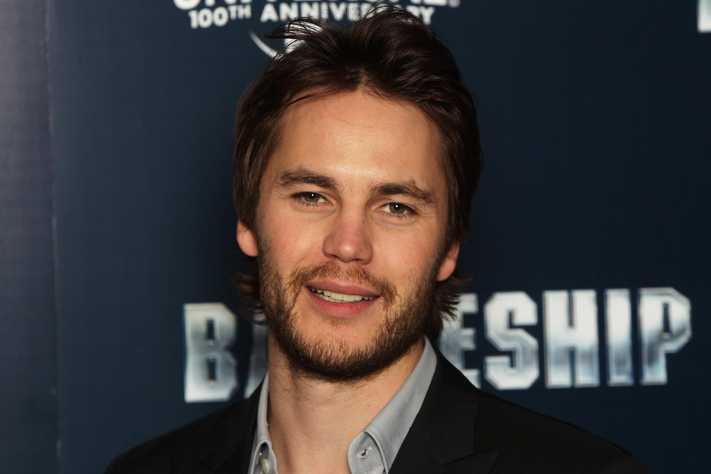 Taylor Kitsch attended a photo call for Battleship in London.