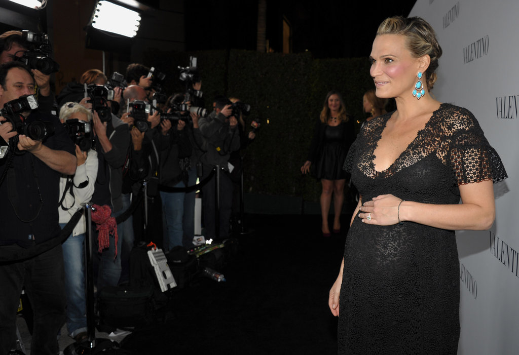 Molly Sims attended Valentino's 50th anniversary party while pregnant in LA.