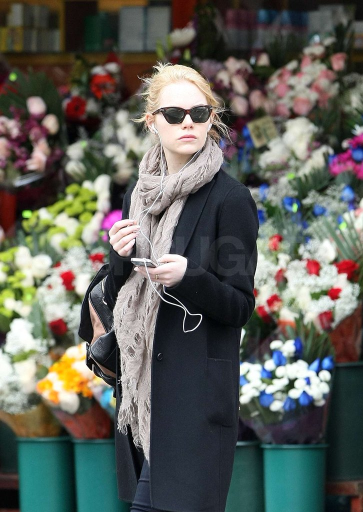 Emma Stone kept warm while walking in NYC.