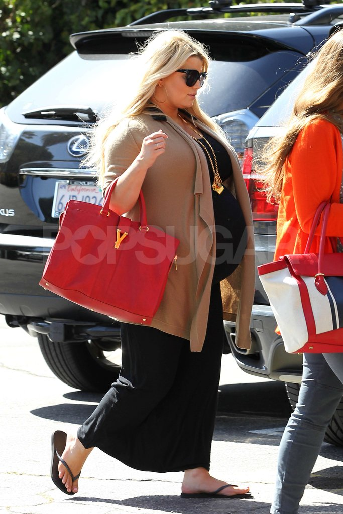 Pregnant Jessica Simpson carried a red YSL bag shopping with a friend in LA.