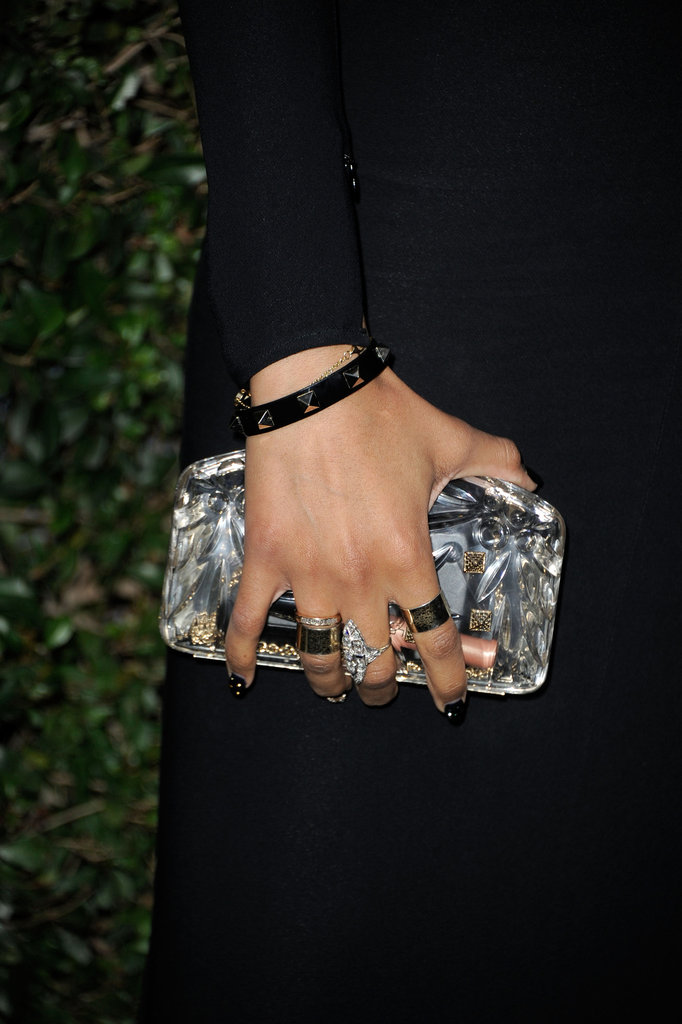 A studded bracelet, gold rings, and a Lucite clutch completed Ciara's look.