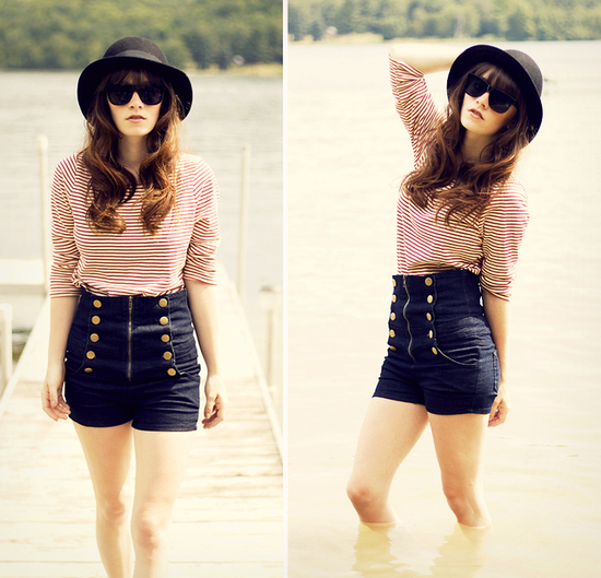 High-waist shorts and a striped top makes for a fun, nautical-inspired outfit. Notice how she gives this look a modern touch via dark sunglasses and a statement hat.  Photo courtesy of lookbook.nu