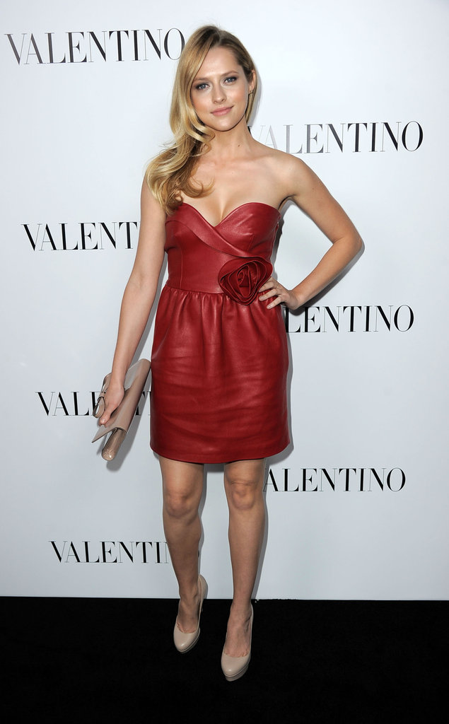 Actress Teresa Palmer played it sweet-cum-sexy in a red leather Valentino strapless with a rosette at the waist.