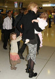 Nicole Kidman held on tight to her daughters in the airport in Australia.