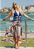 Paris Hilton sunbathed at Bondi Beach in a blue bathing suit with cutouts.