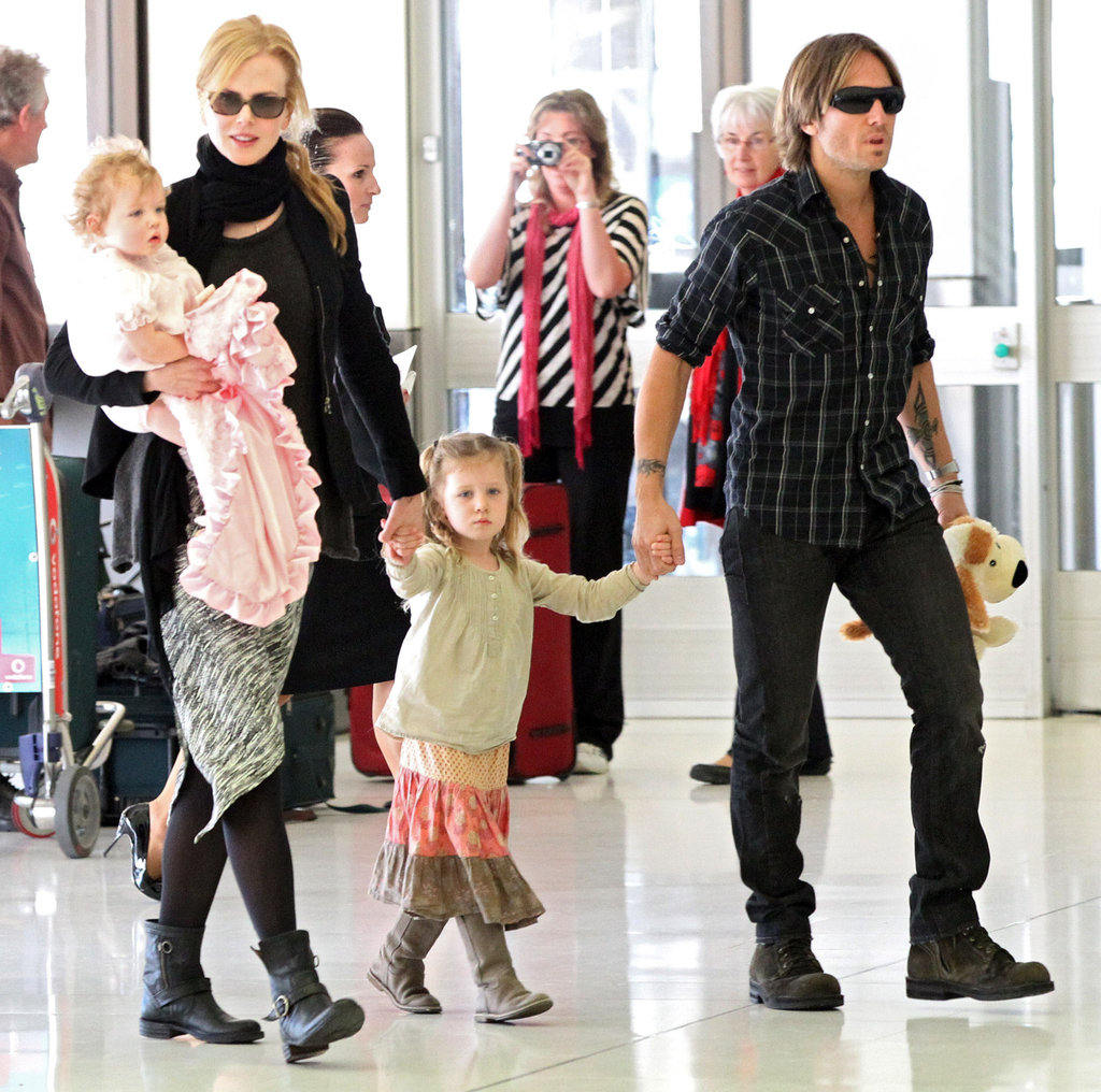 Nicole Kidman and Keith Urban boarded a flight out of Australia with daughters Faith and Sunday.