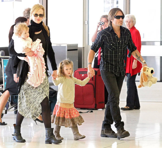 Nicole Kidman and Keith Urban held daughters Sunday and Faith close as they made their way through and Australian airport.