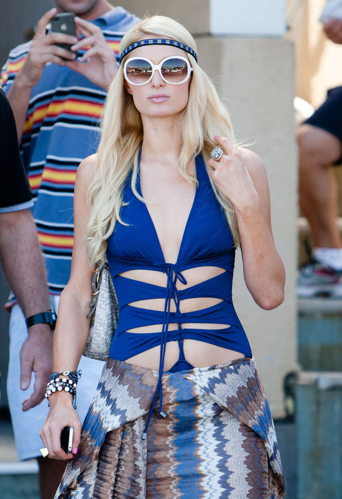 Paris Hilton wore a blue bathing suit with cutouts to Bondi Beach in Australia.