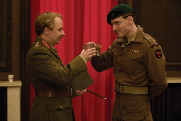Michael Fassbender had a sly smile on his face while shooting an Inglourious Basterds scene with Mike Myers.