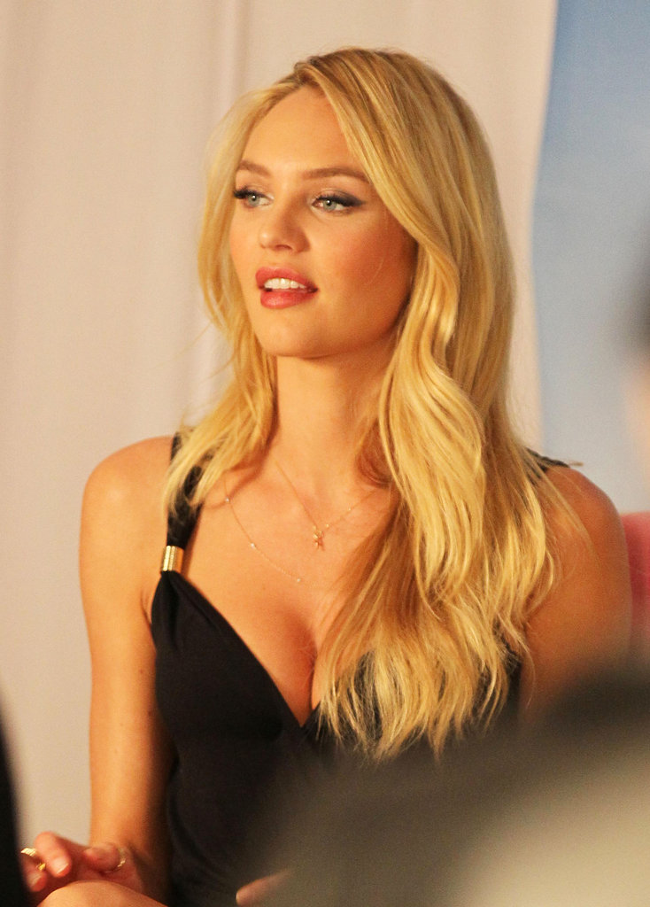 Candice Swanepoel in a black dress.