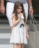 Suri Cruise wore a polka-dot skirt.