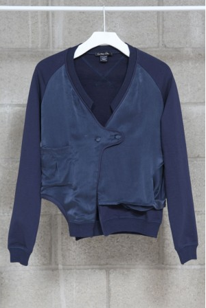 """""""This cardigan is a cool mix of athletic sports bomber jacket and soft femme textures. It not only hits upon some of Spring's more prevalent trends, but also happens to be an offbeat piece perfect for my wardrobe. """" — Marisa Tom, associate editor  Mikkat Market Satin Sweatshirt Cardigan ($53)"""