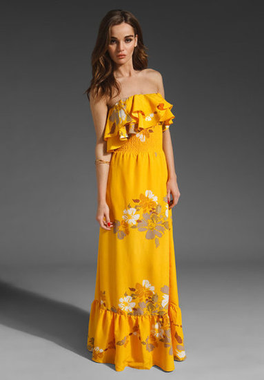 Oh, how we love a pretty ruffled dress for Spring — this one is perfect for a rooftop or outdoor soiree.  MM Couture Ruffle Top Maxi Dress ($94)