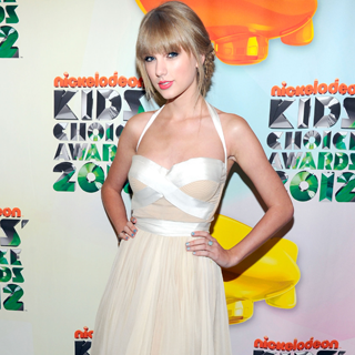 Taylor Swift in White J. Mendel at ACM Awards
