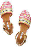 """""""I like that the colorful stripes aren't quite tribal, but they do remind me of something straight from New Mexico's art scene. Plus, I have a feeling ankle-strap flat sandals will be my Summer sole go-to."""" — Marisa Tom, associate editor  Carven Striped Jacquard and Leather Sandals ($595)"""