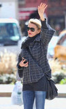 Cameron Diaz raised her arm to hail a cab in the West Village in NYC.