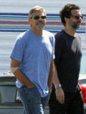 George Clooney wore a light blue t-shirt and sunglasses on set at the airport in Los Angeles.
