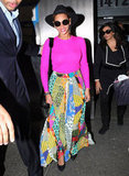 Switch up the printed pant look with an ultracolorful skirt. Here, she juxtaposed a hot-pink Michael Kors sweater with a vibrant Etro maxi skirt and her go-to Linda Farrow for The Row sunglasses. Would you replicate this bold outfit?