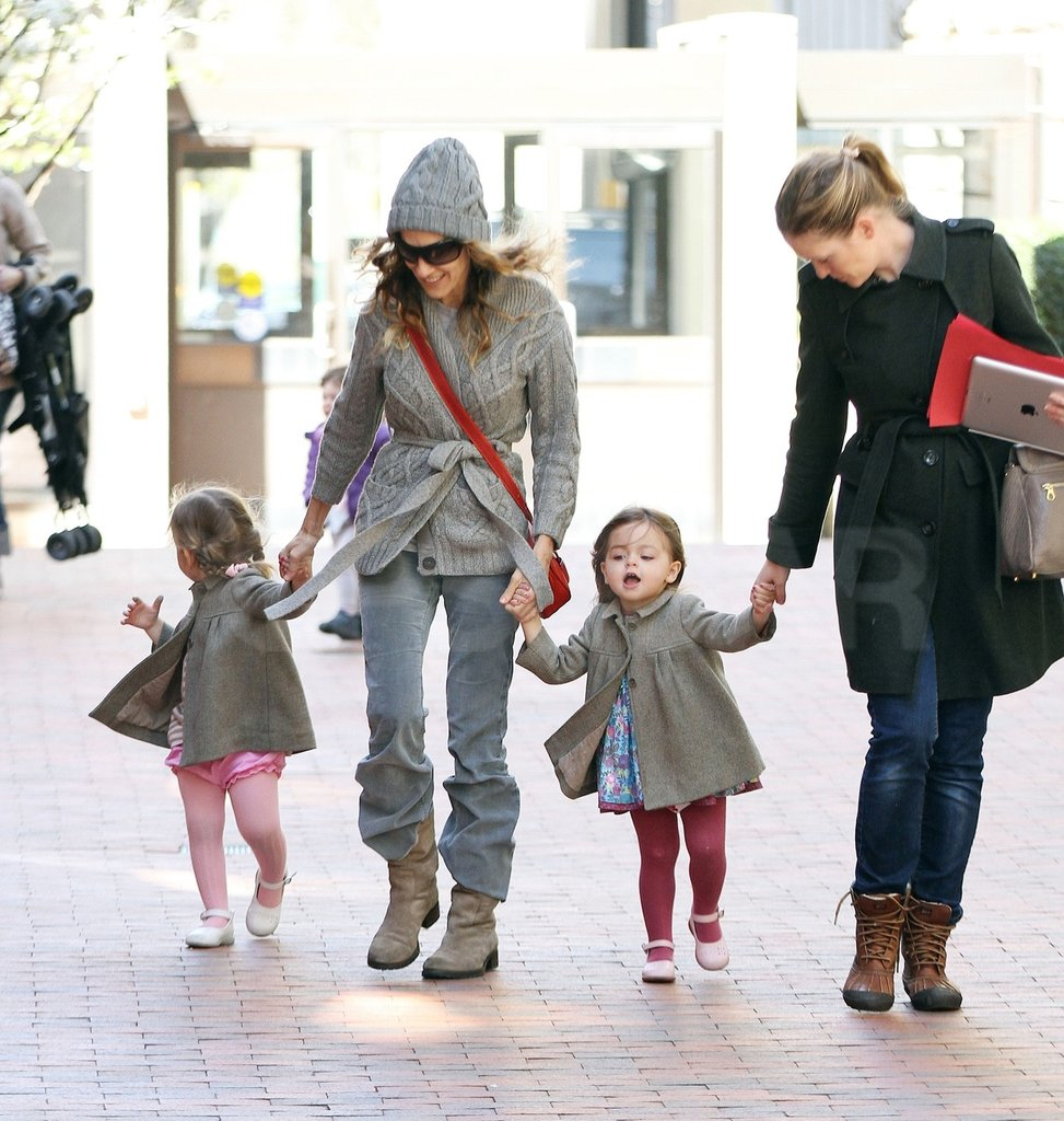 Sarah Jessica Parker walks hand in hand with her daughters in NYC.