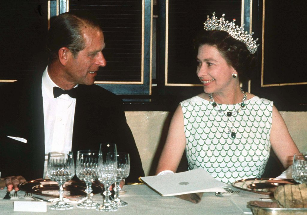 Queen Elizabeth II and Prince Philip smiled at each other at a state banquet in 1970.