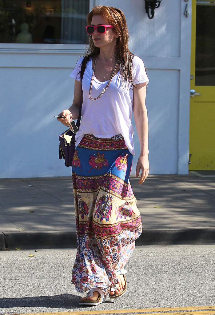Isla Fisher left a hair salon in LA wearing hot pink sunglasses and a maxi skirt.
