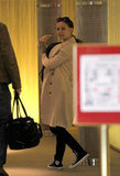 Natalie Portman carried son Aleph through the airport in Paris.