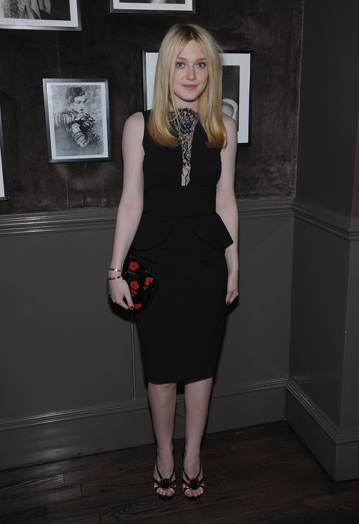 Dakota Fanning wore a black peplum dress to a private Elie Saab dinner in NYC.