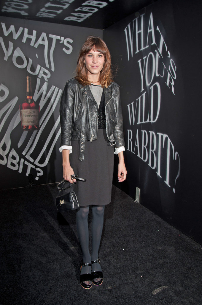 Alexa Chung layered up in all black and a rocker-chic leather jacket for an event in NYC.