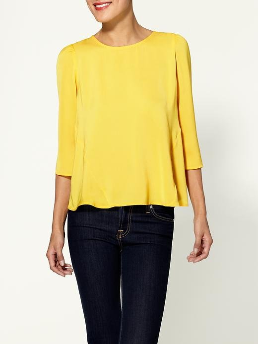 This daffodil top would add a festive touch to almost anything — even your skinny jeans.  DV by Dolce Vita Sacha Blouse ($88)