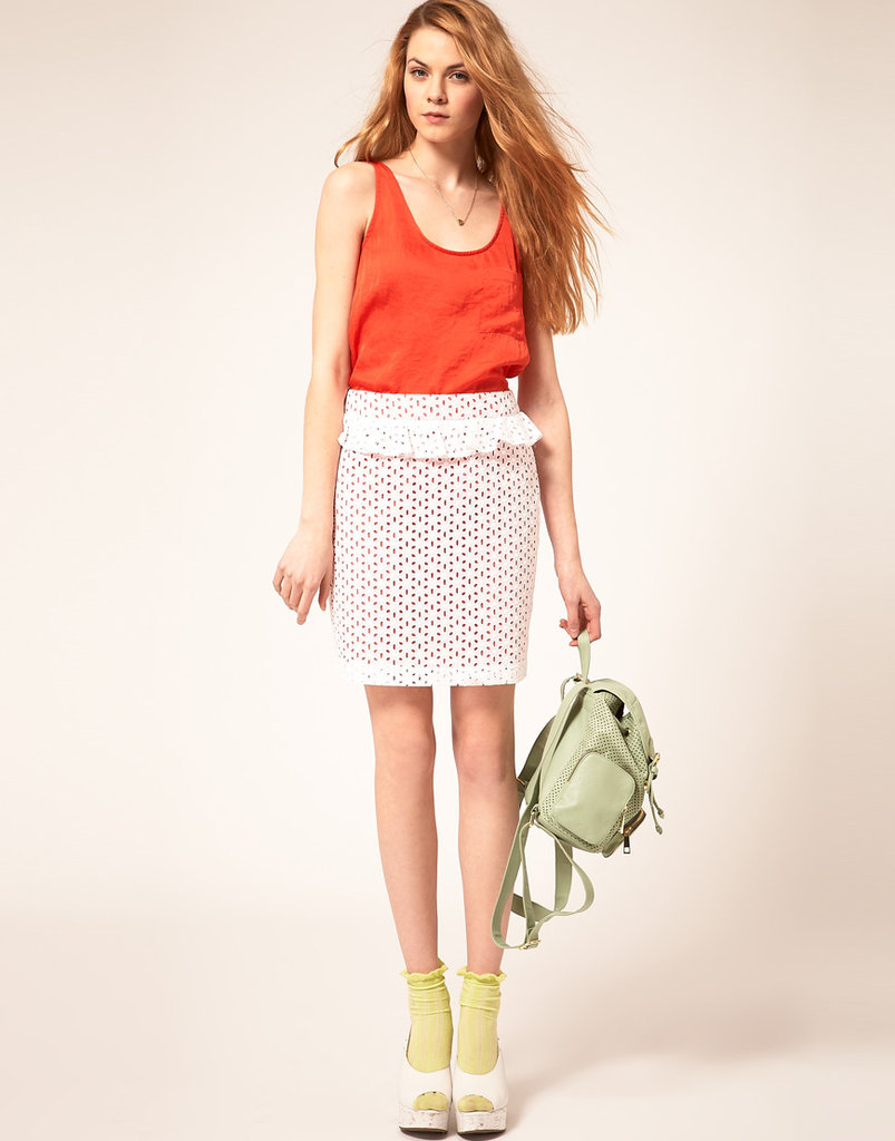 We love the girlie quality of this peplum-adorned pencil.  Asos Peplum Mini Skirt in Broderie Anglaise ($54)