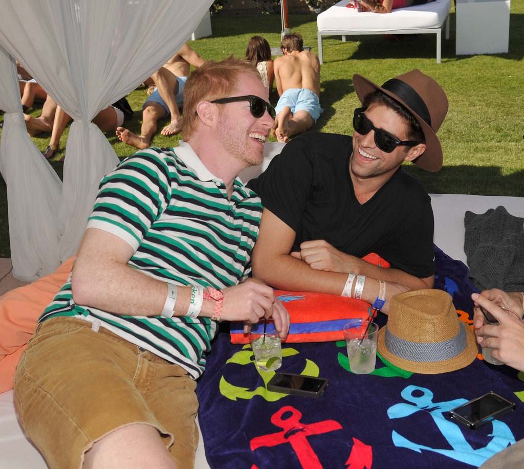 Jesse Tyler Ferguson and his boyfriend Justin Mikita lounged together during Lacoste's pool party.
