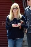 Pregnant Reese Witherspoon checked her phone.