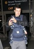 Orlando Bloom arrived at LAX for a flight.