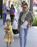 Jessica Alba bundled up in a scarf as she and daughter Honor Warren took a walk in LA.