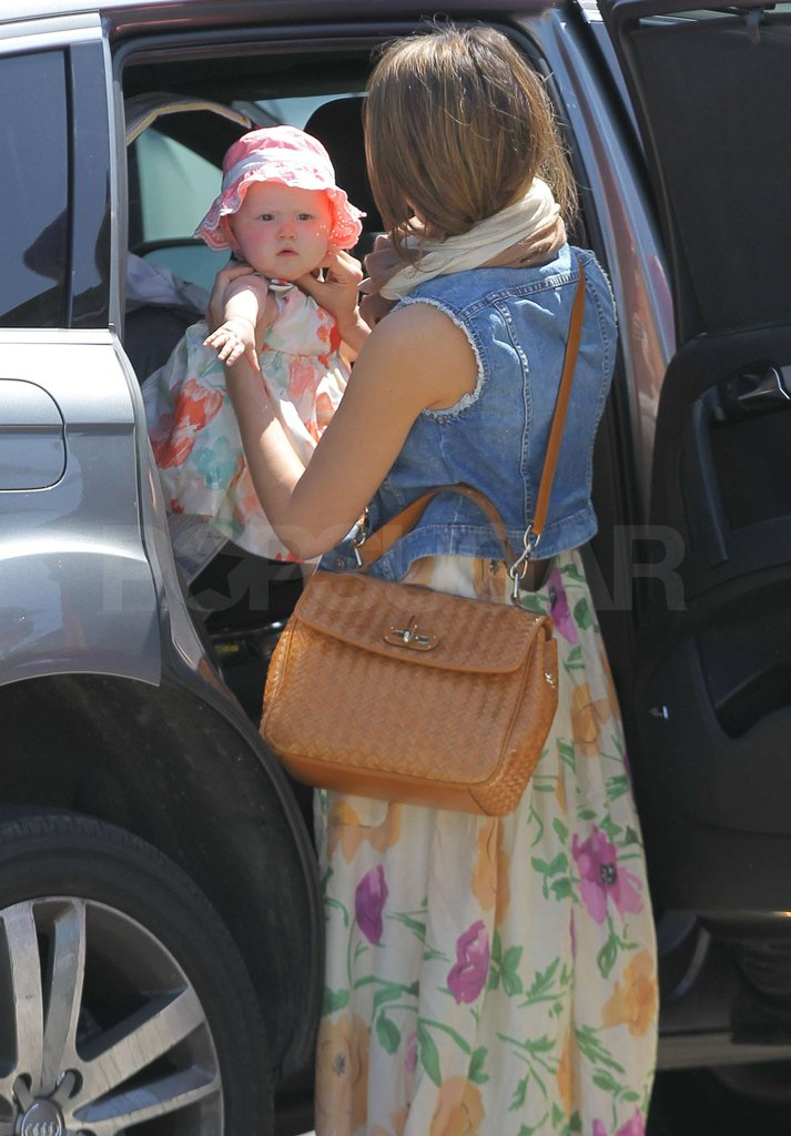 Jessica Alba grabbed baby Haven Warren from the back seat.