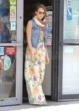 Jessica Alba looked ready for Spring in a floral printed maxi dress and denim vest.