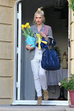 Gwen Stefani balanced flowers and an oversized blue hobo bag in Orange County.